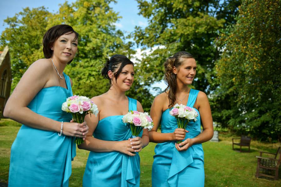 bridesmaids waiting for the bride at St James Church, Weddington