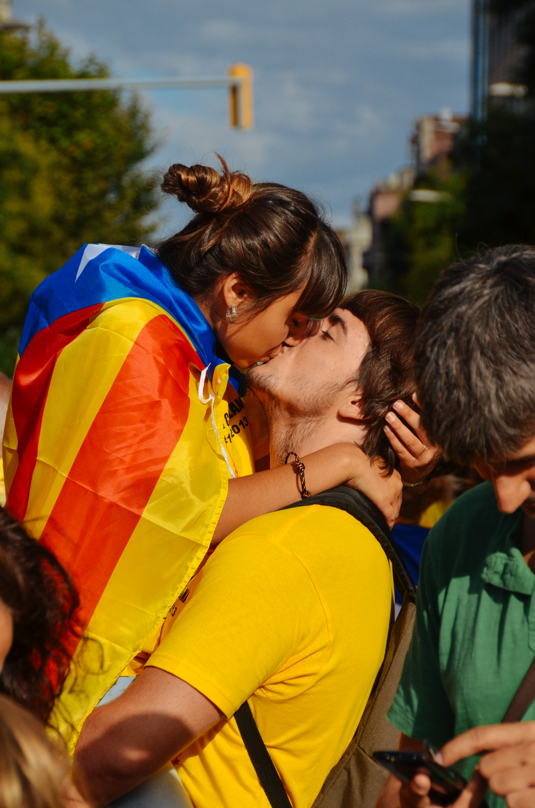 Couple kissing at the Catalan human chain, Plaça de Sants, Barcelona - Catalan referendum