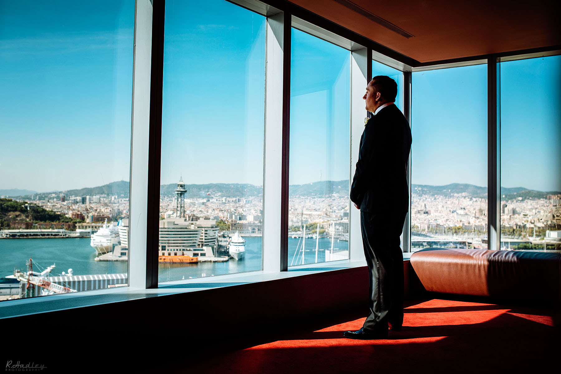 Wedding preparation at the W hotel in Barcelona, Spain. Groom overlooking the city.